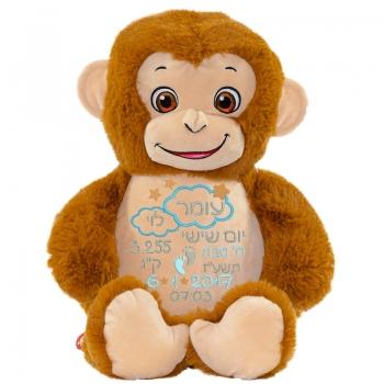 בובה עם רקמה בדמות קוף